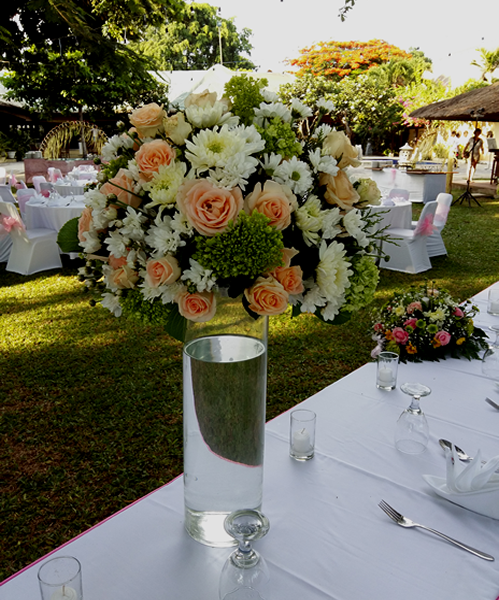 Mix flower centerpiece in tall glass vases bali vintage