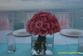 pink rose centerpiece in kotako vases
